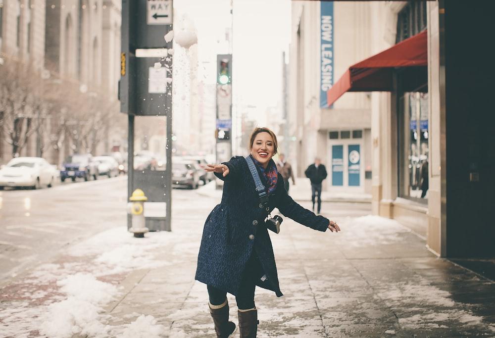 woman wearing coat on street