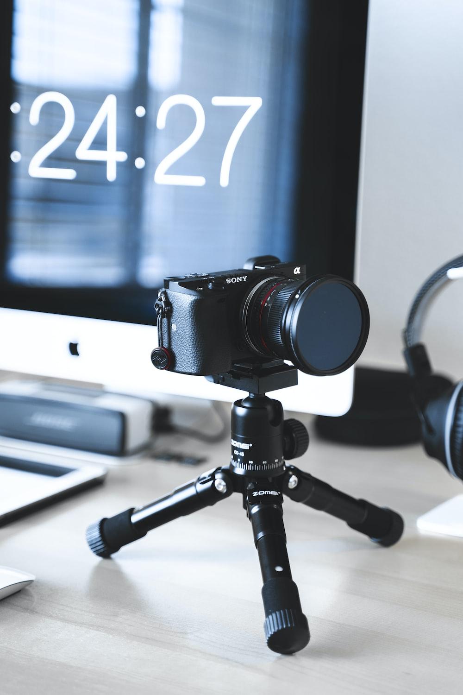 black Sony camera with tripod