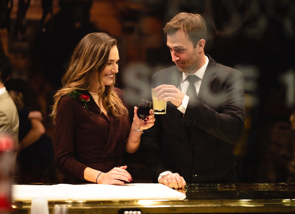 man and woman making a toast