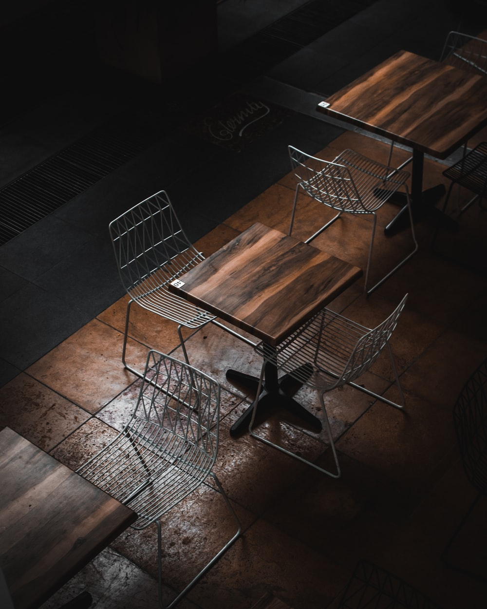 table with chairs placed on brown floor