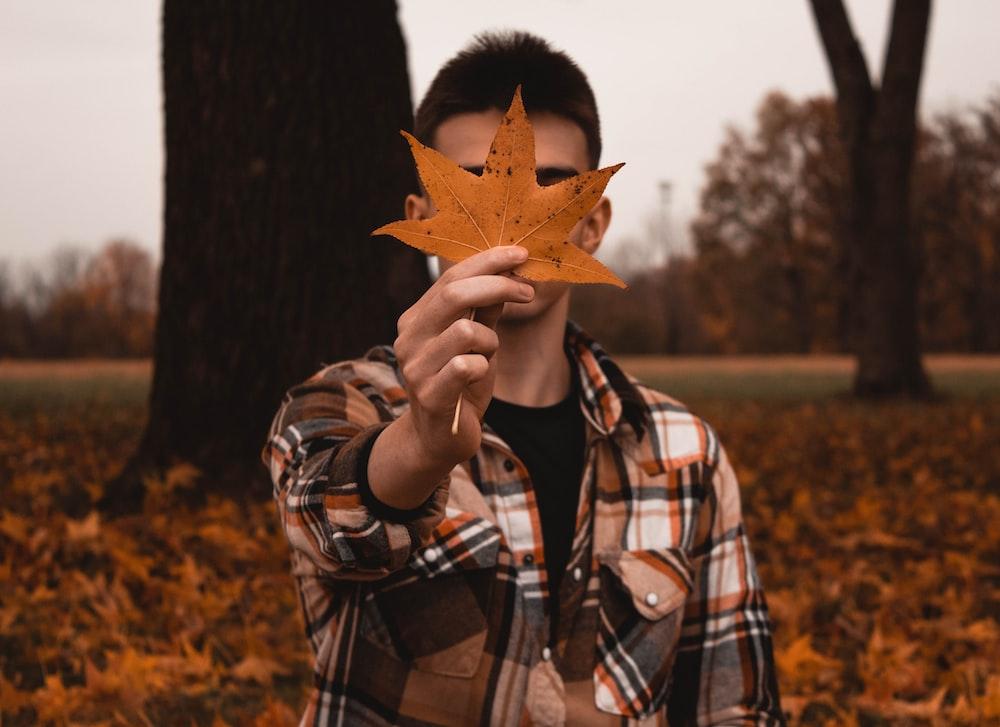 man holding maple leaf