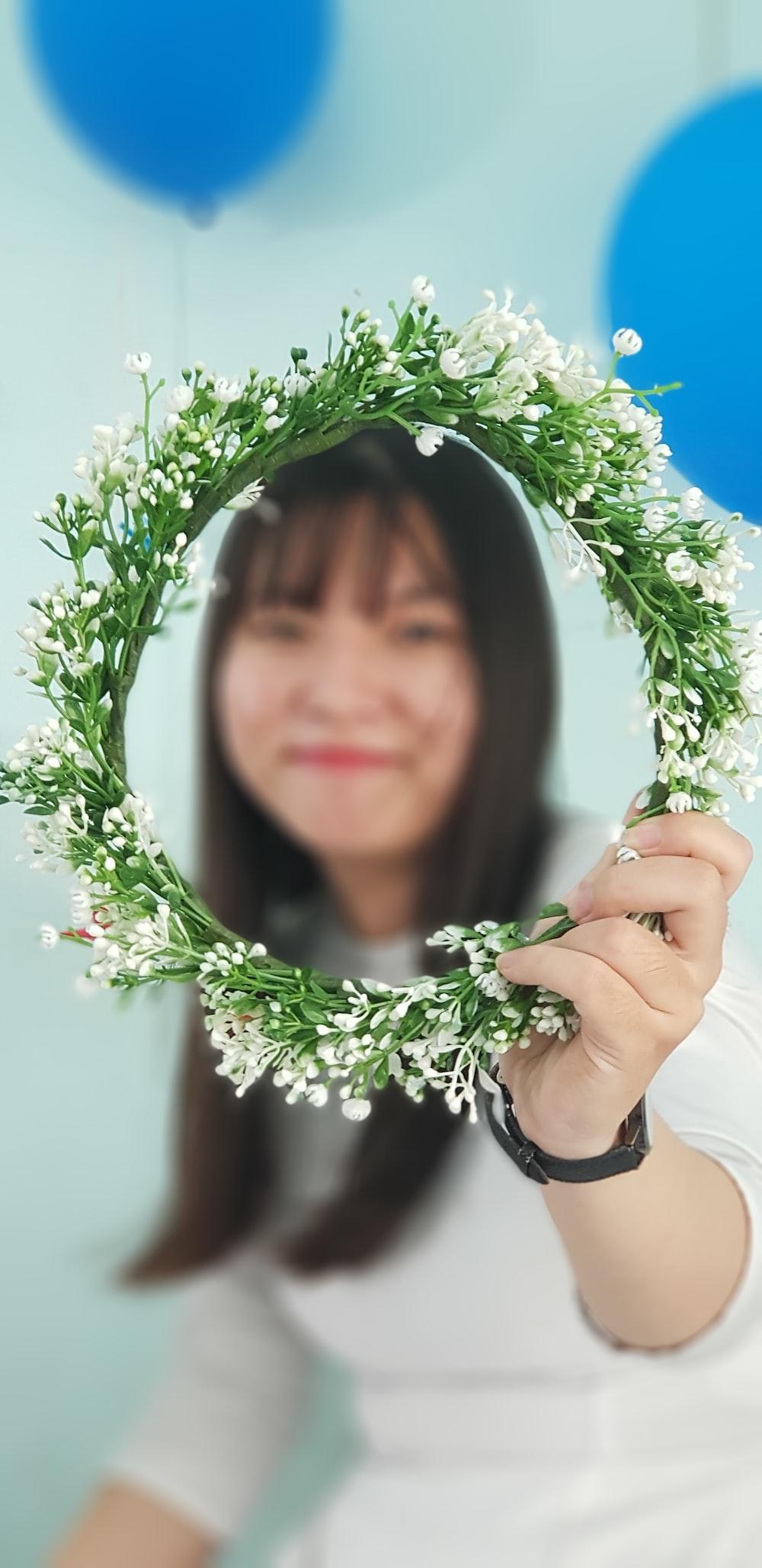 woman holding green wreath