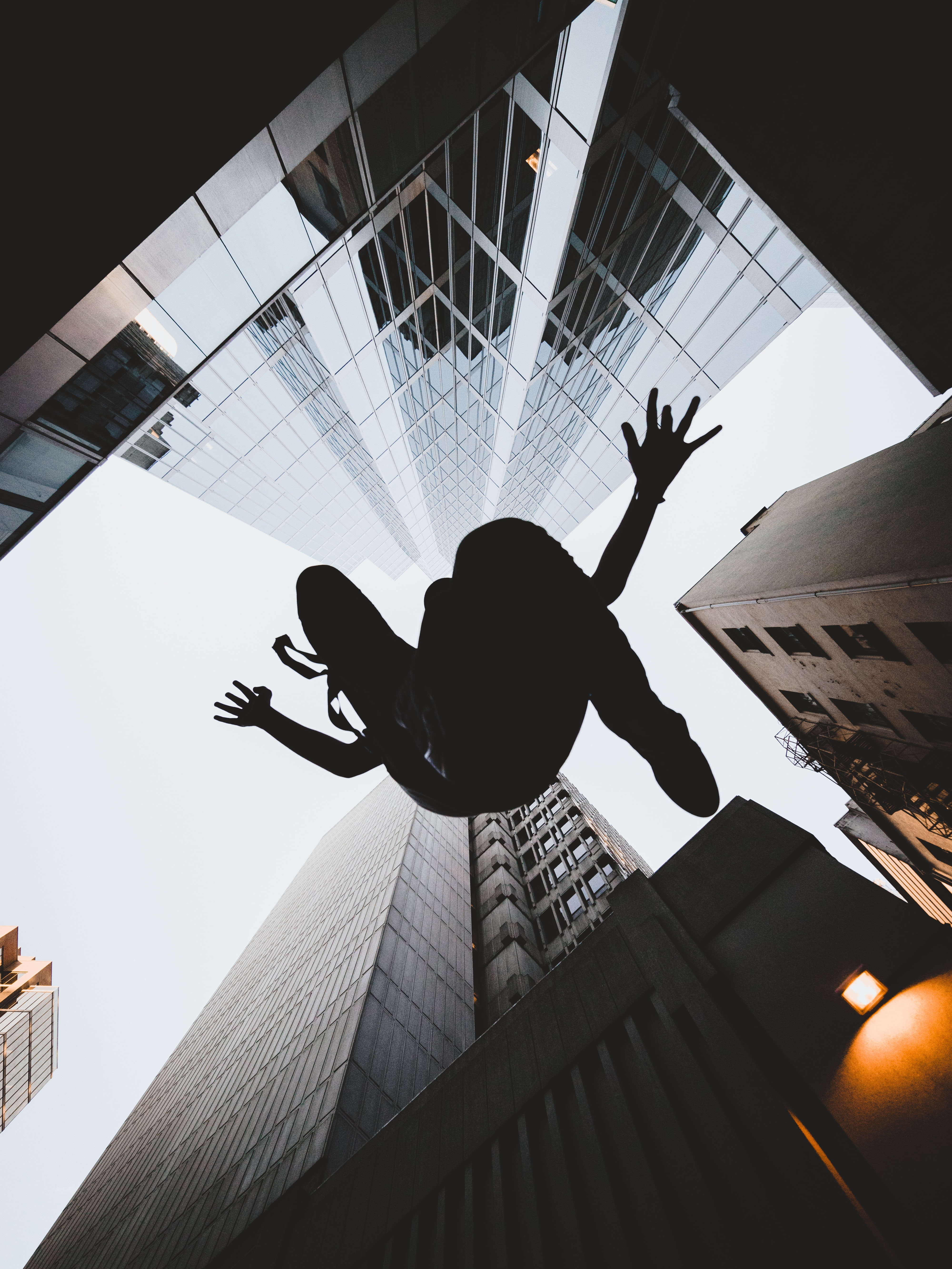 silhouette of person jumping during daytime