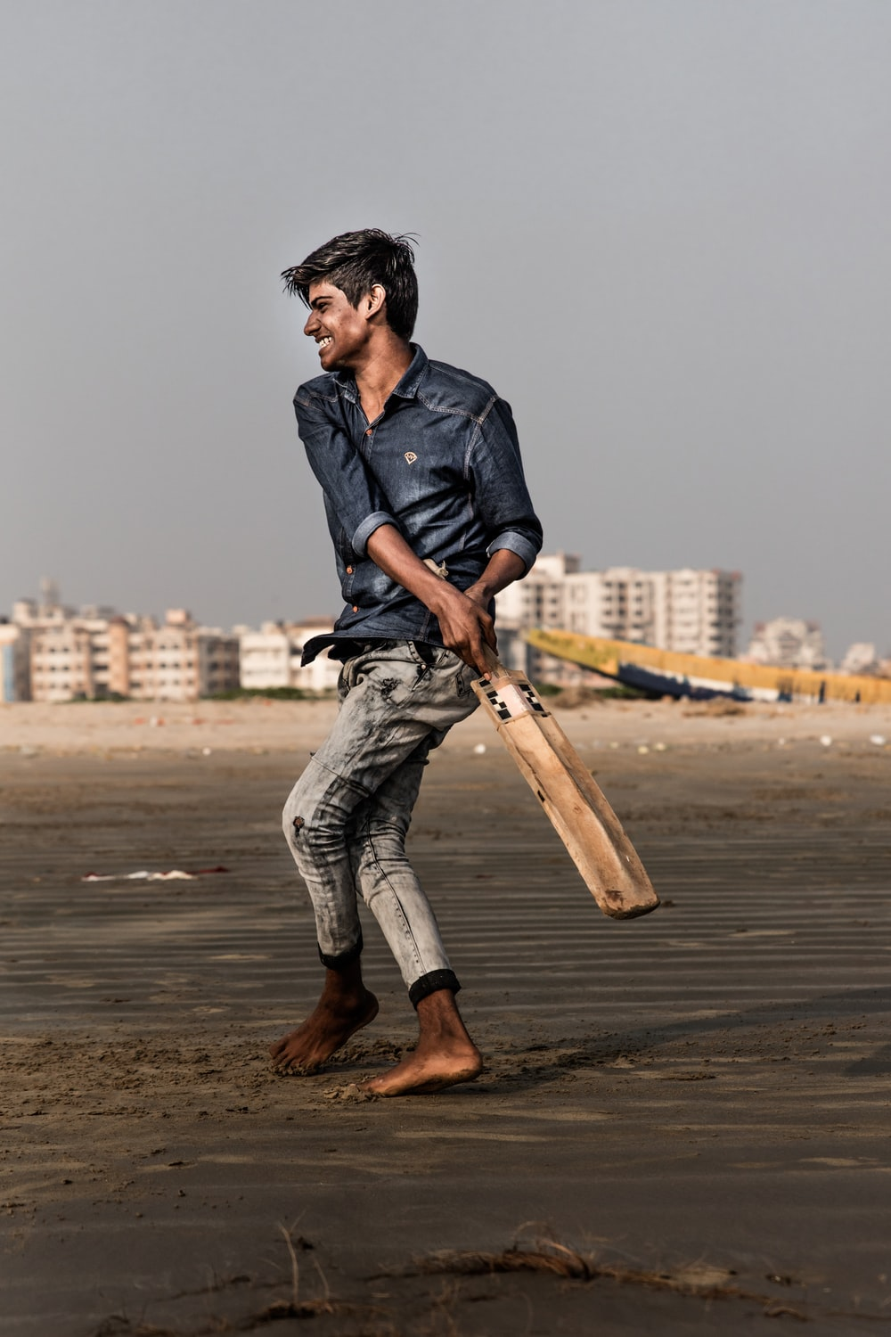 man holding cricket bat