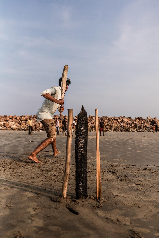 person holding cricket bat