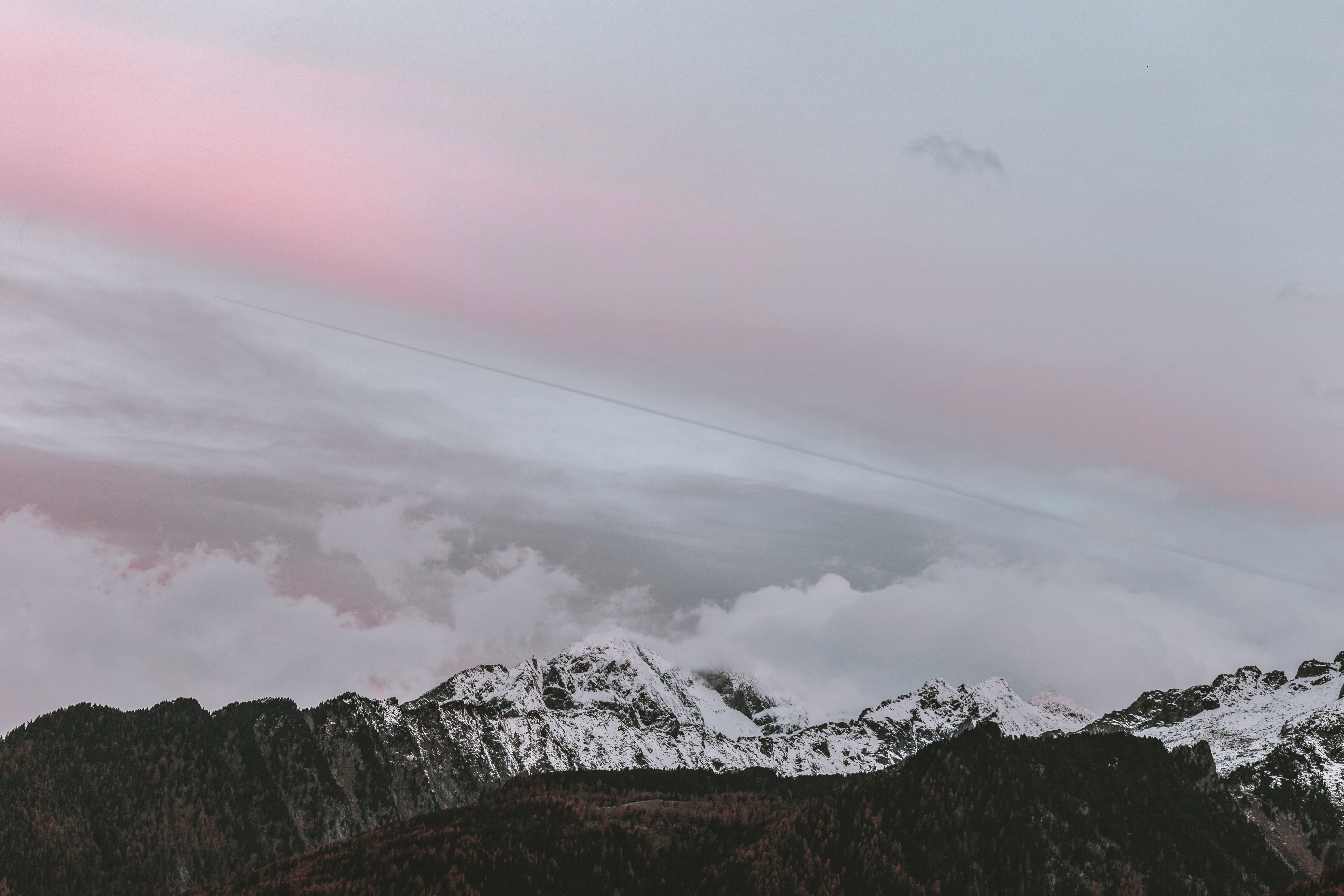 white clouds near snow-capped mountain