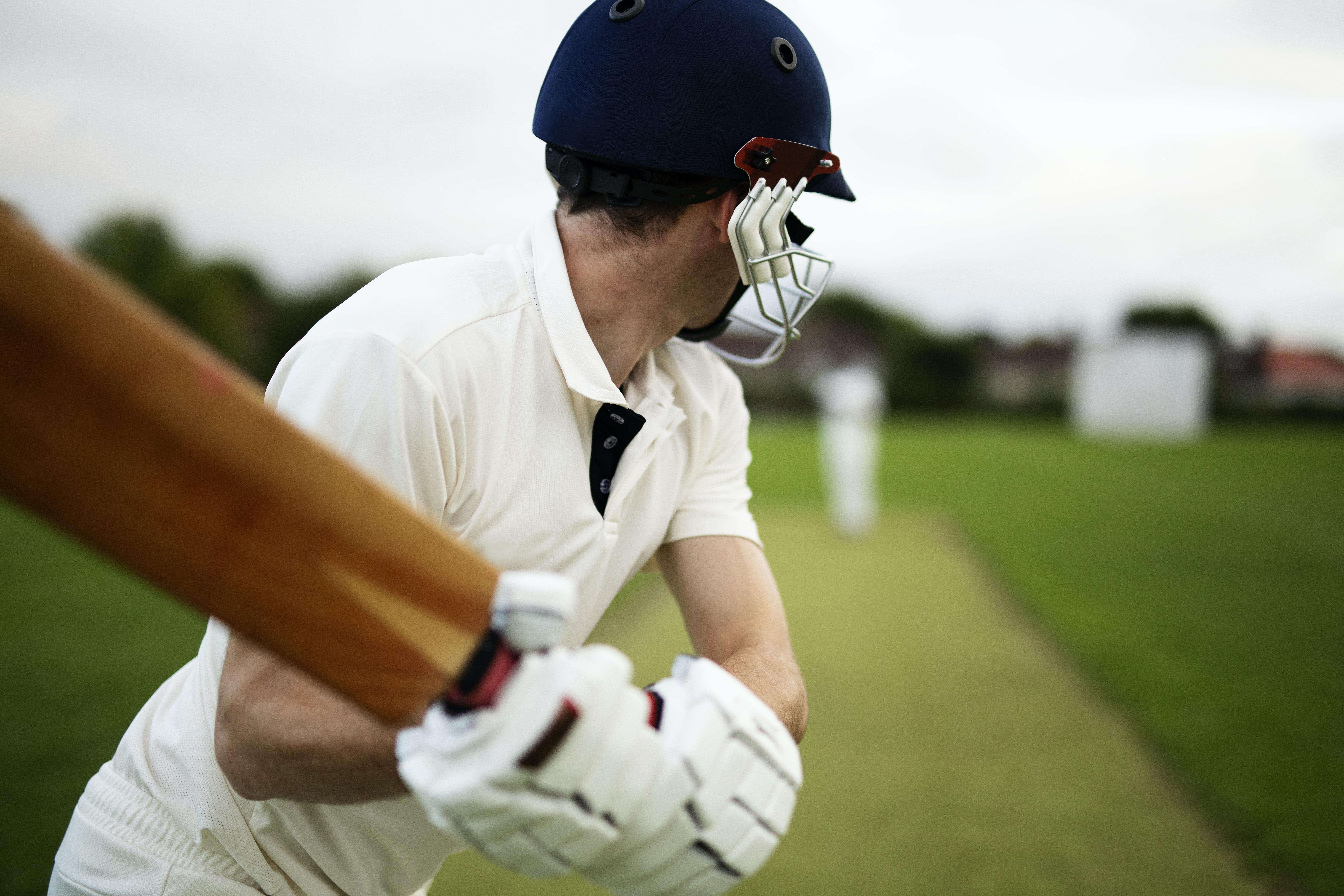 person playing cricket bat during daytime