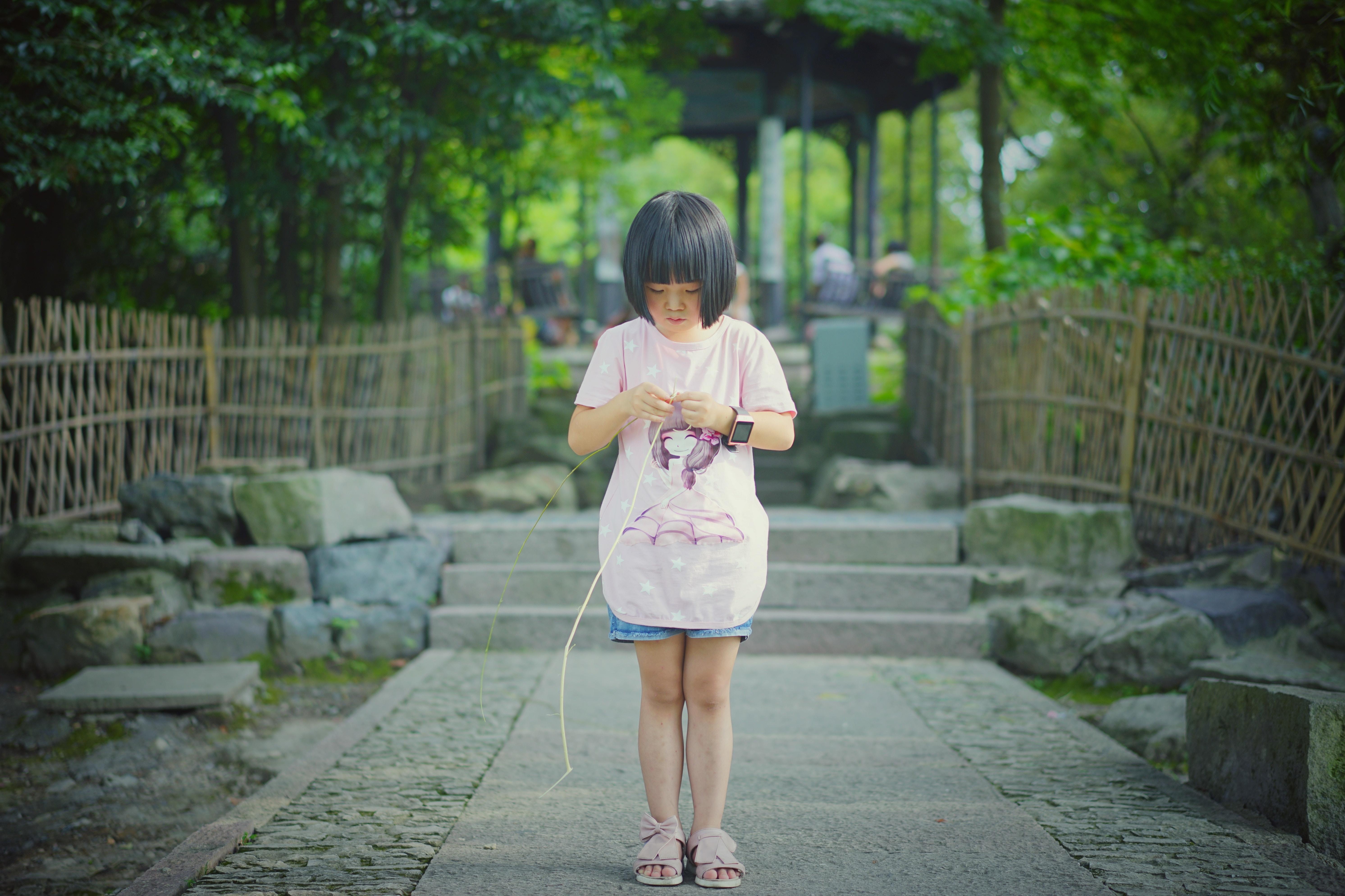 girl holding twig