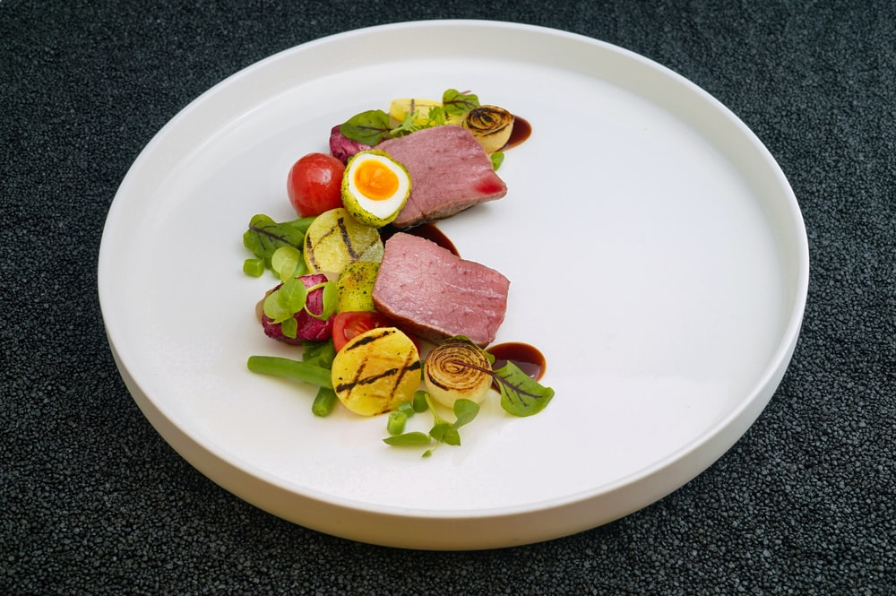 cooked food and vegetables on white plate
