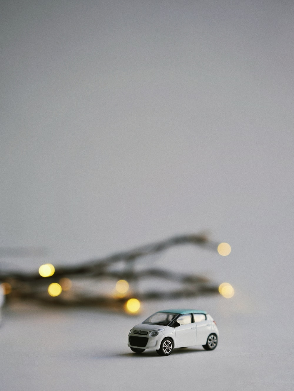 white car miniature in selective focus photography