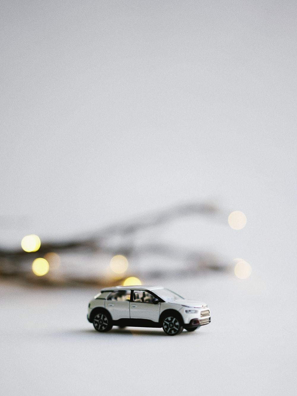 selective focus photography of white SUV miniature
