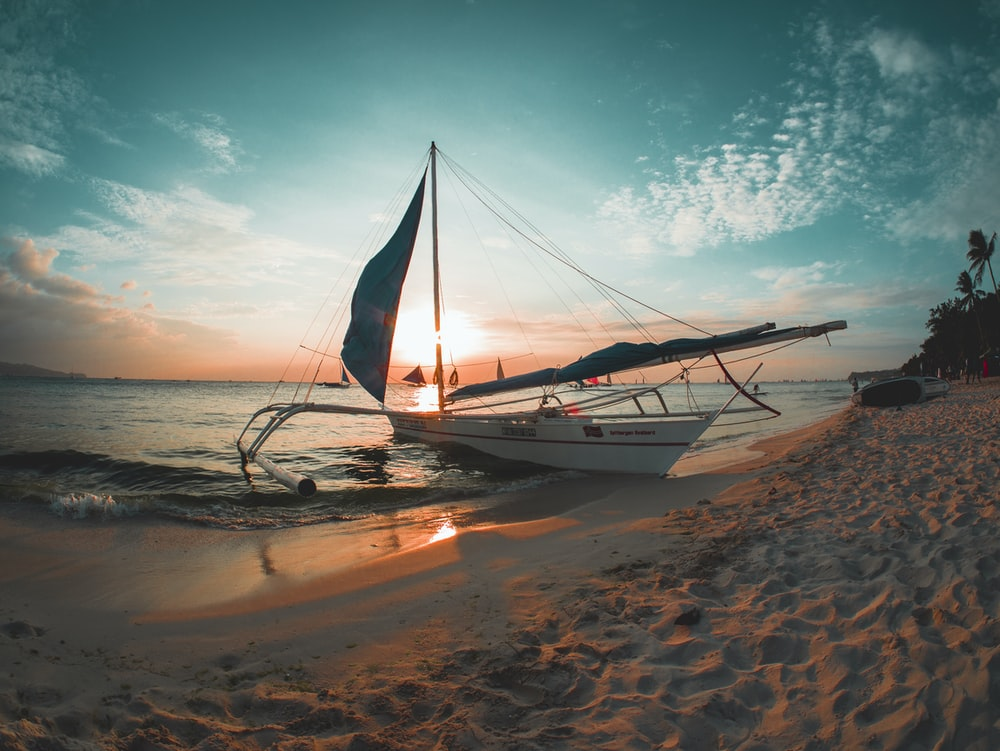 white boat docked on seashore