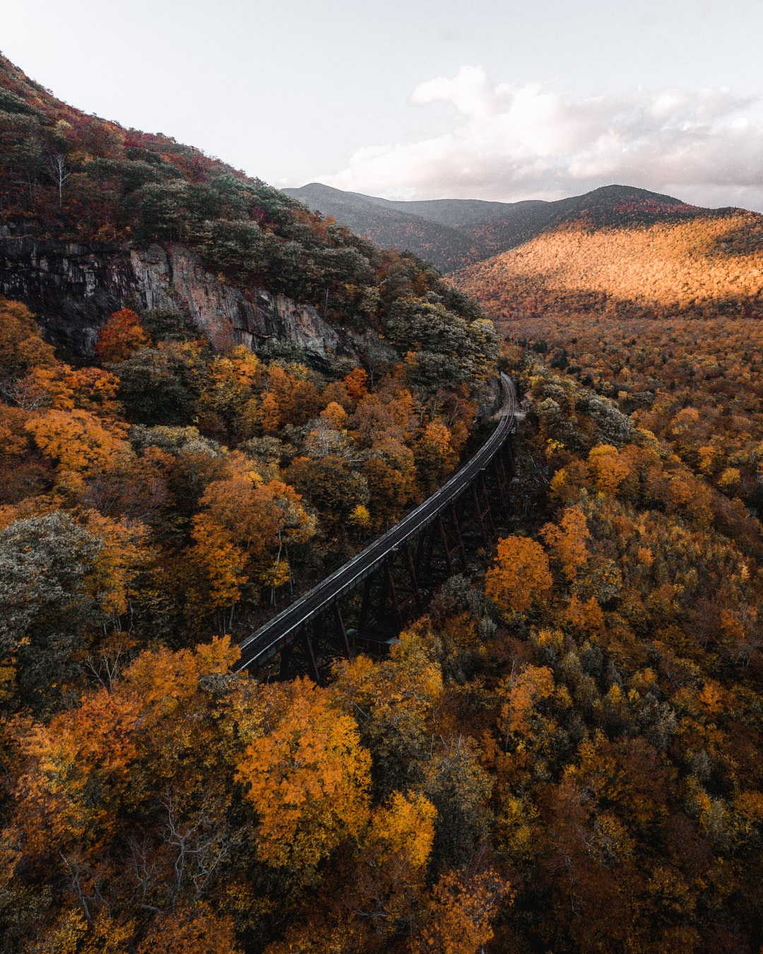 Follow me on Instagram @jevanleith for my latest content!  Here is a wide angle view of the Frankenstein Trestle in Crawford Notch of the White Mountains of NH. This was a bit past peak foliage, but still a great scene!