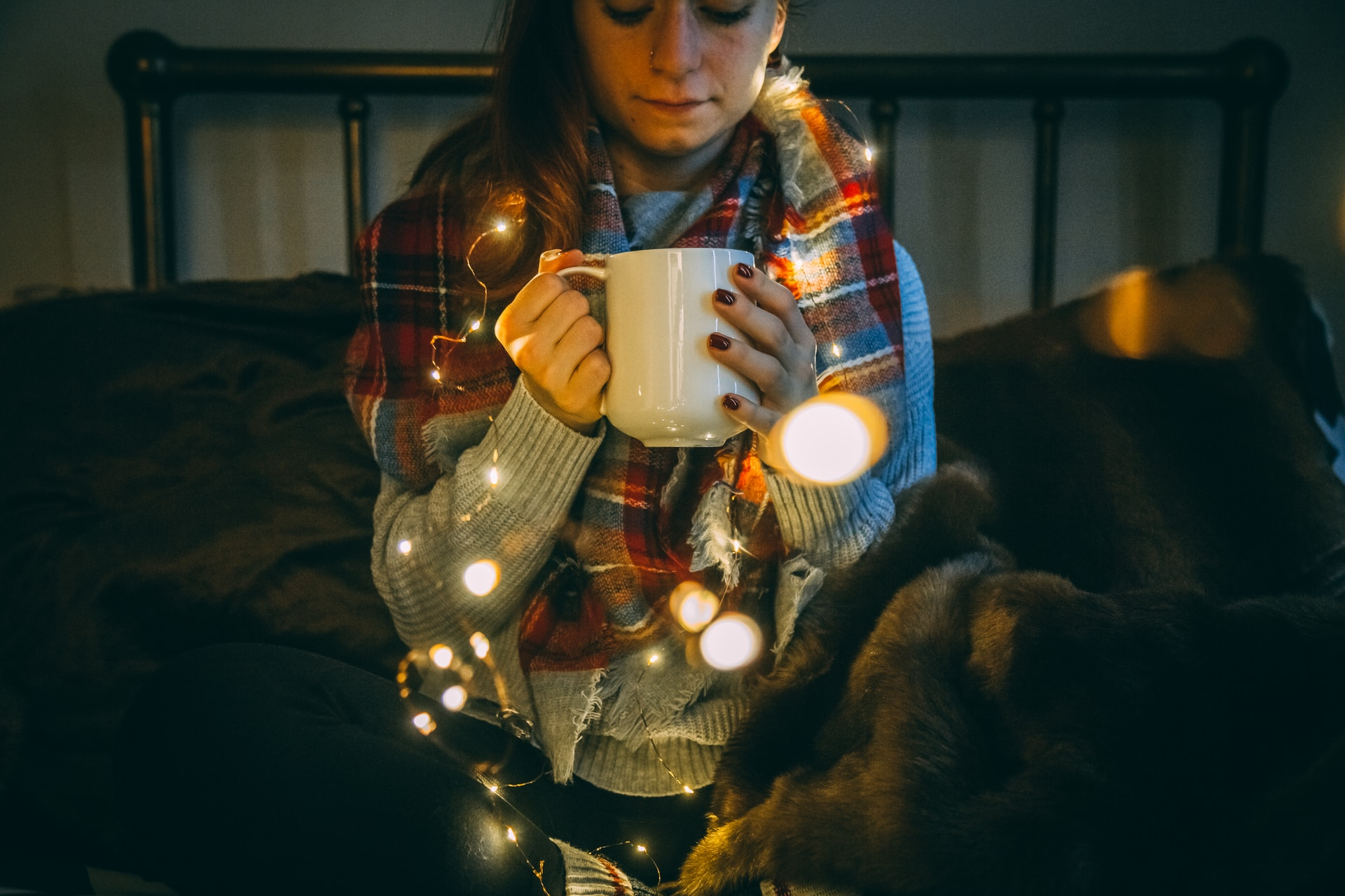 woman holding white mug