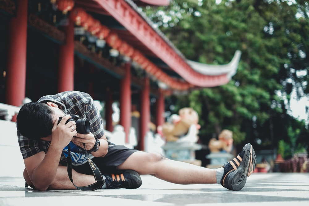 man taking picture at the floor