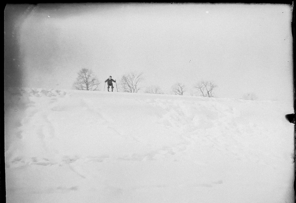 person walking on snow covered ground