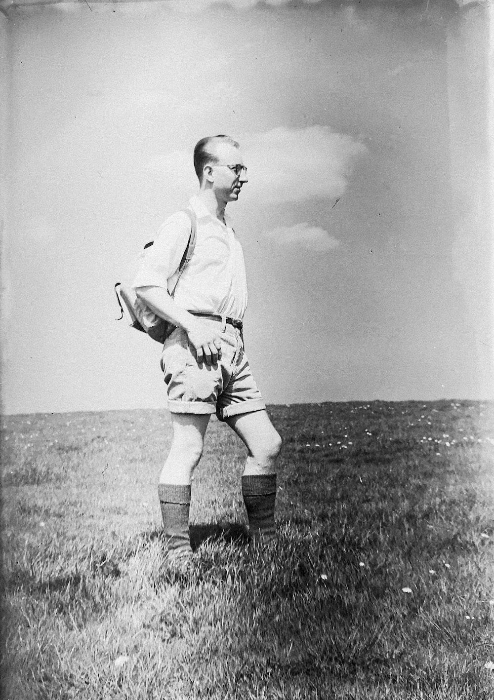 man standing on field photo