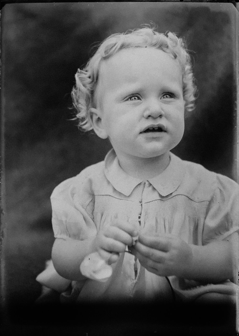 grayscale photography of toddler