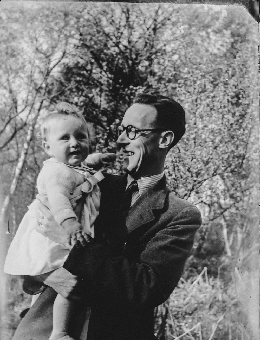 vintage photo of man holding a baby