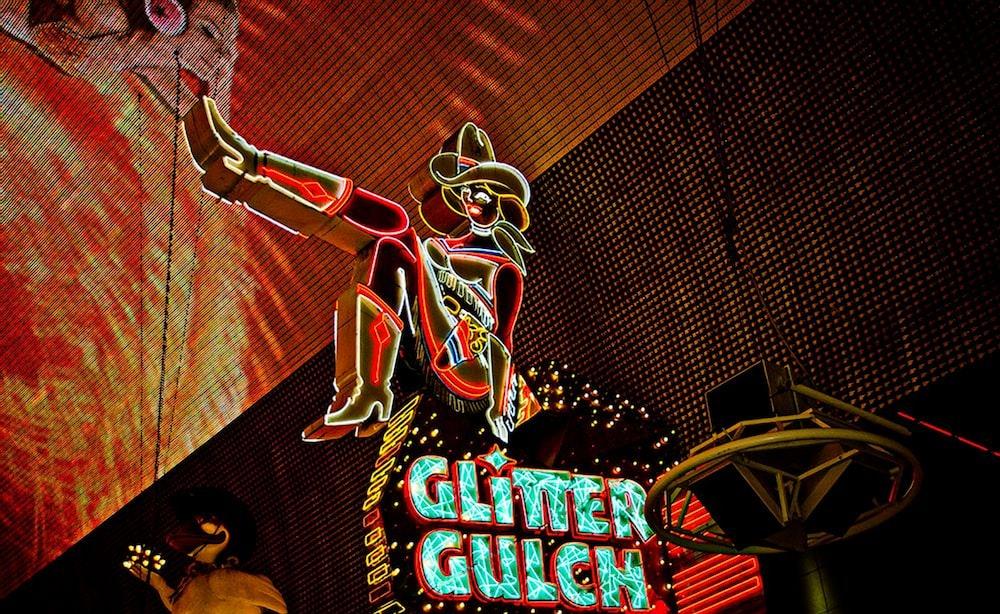 yellow and blue Glitter Gulch NEON signage