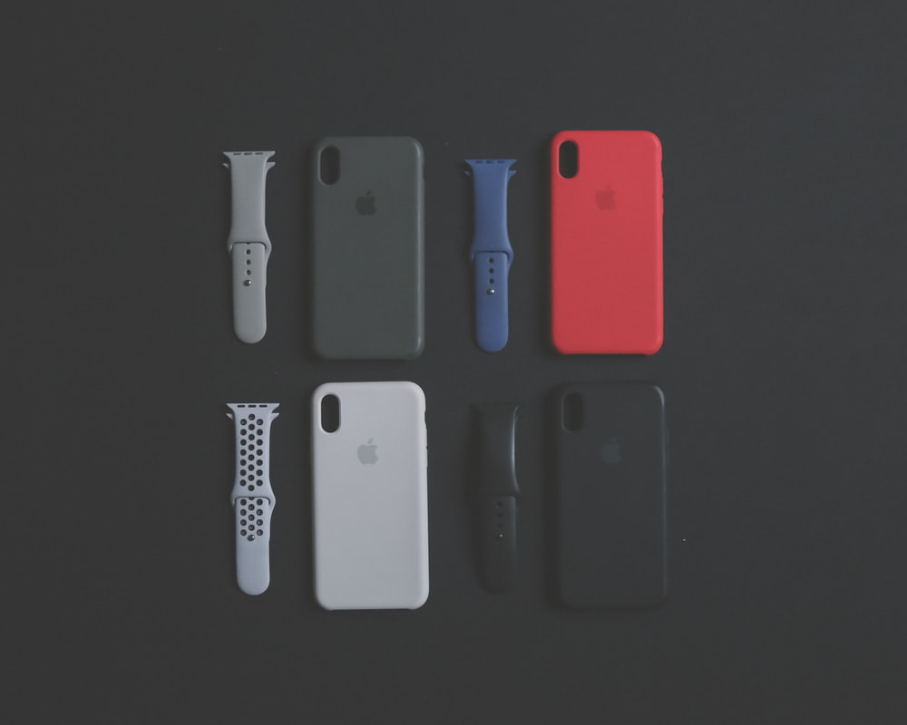 four assorted-color iPhone Xs cases and sports bands