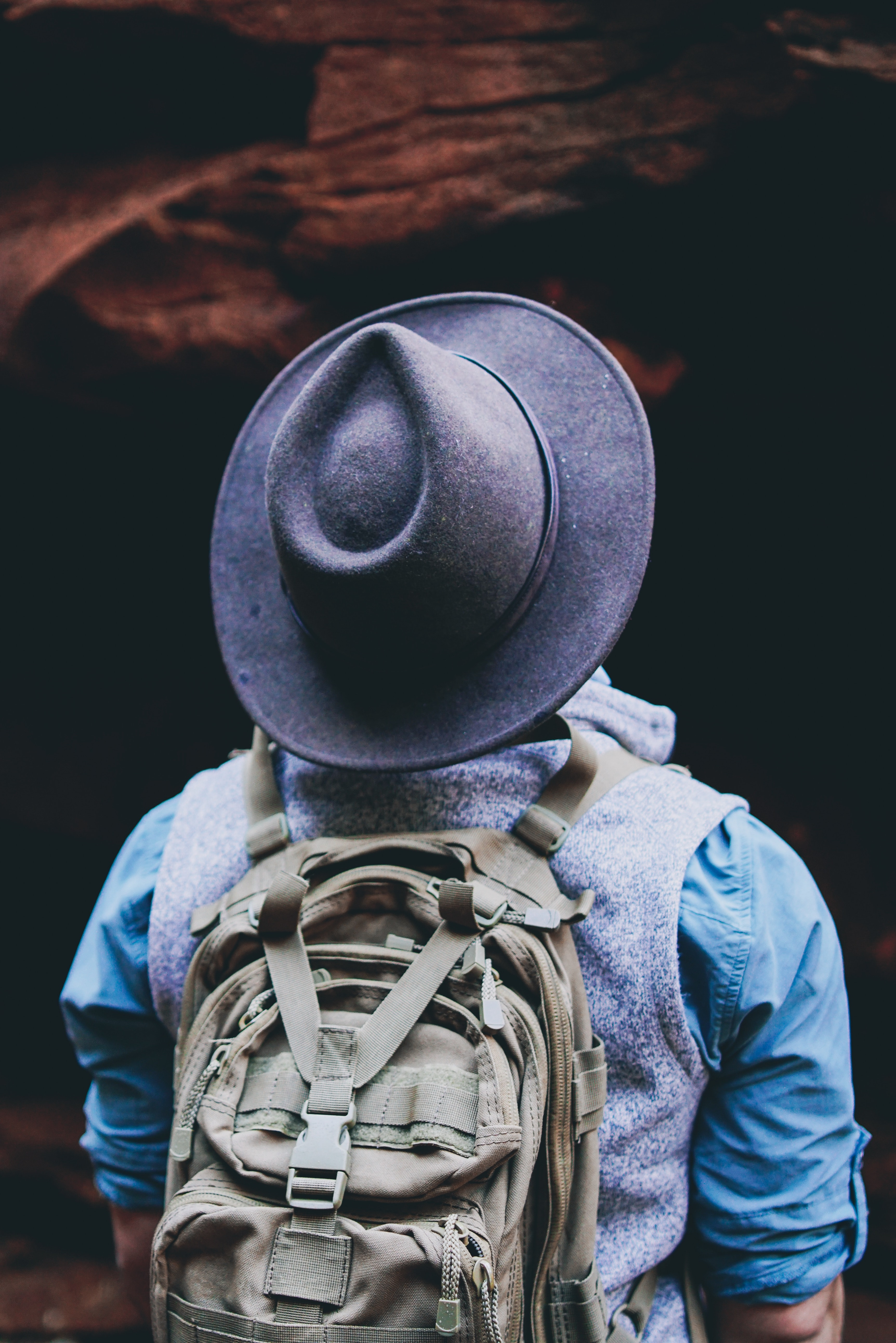 man wearing black hat with backpack