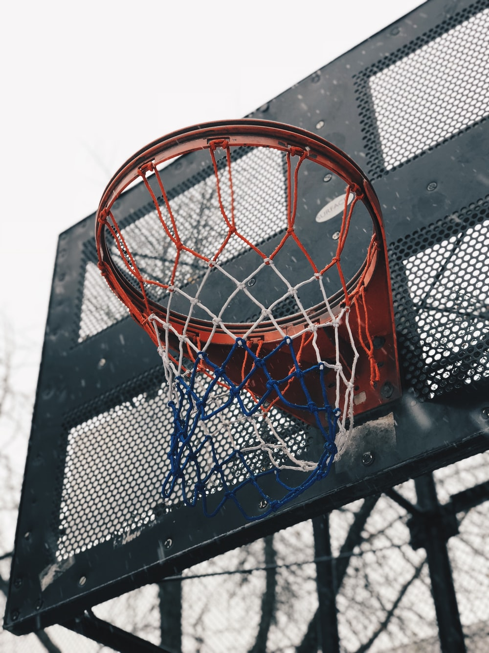 black and red outdoor basketball hoop