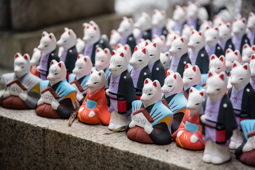 Fujimi Inari shrine comprehend several smaller shrines. One of them was full of these statues of foxes, regarded as the messengers.