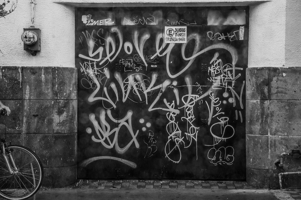 grayscale photography of graffiti