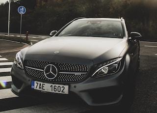 black Mercedes-Benz car on road