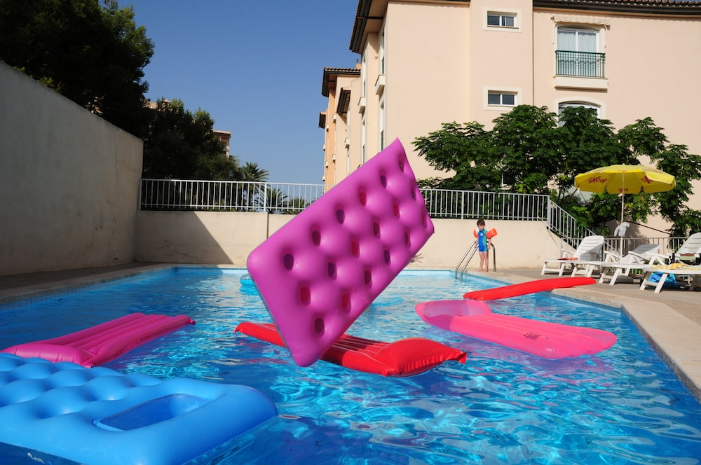 several pool floats on pool