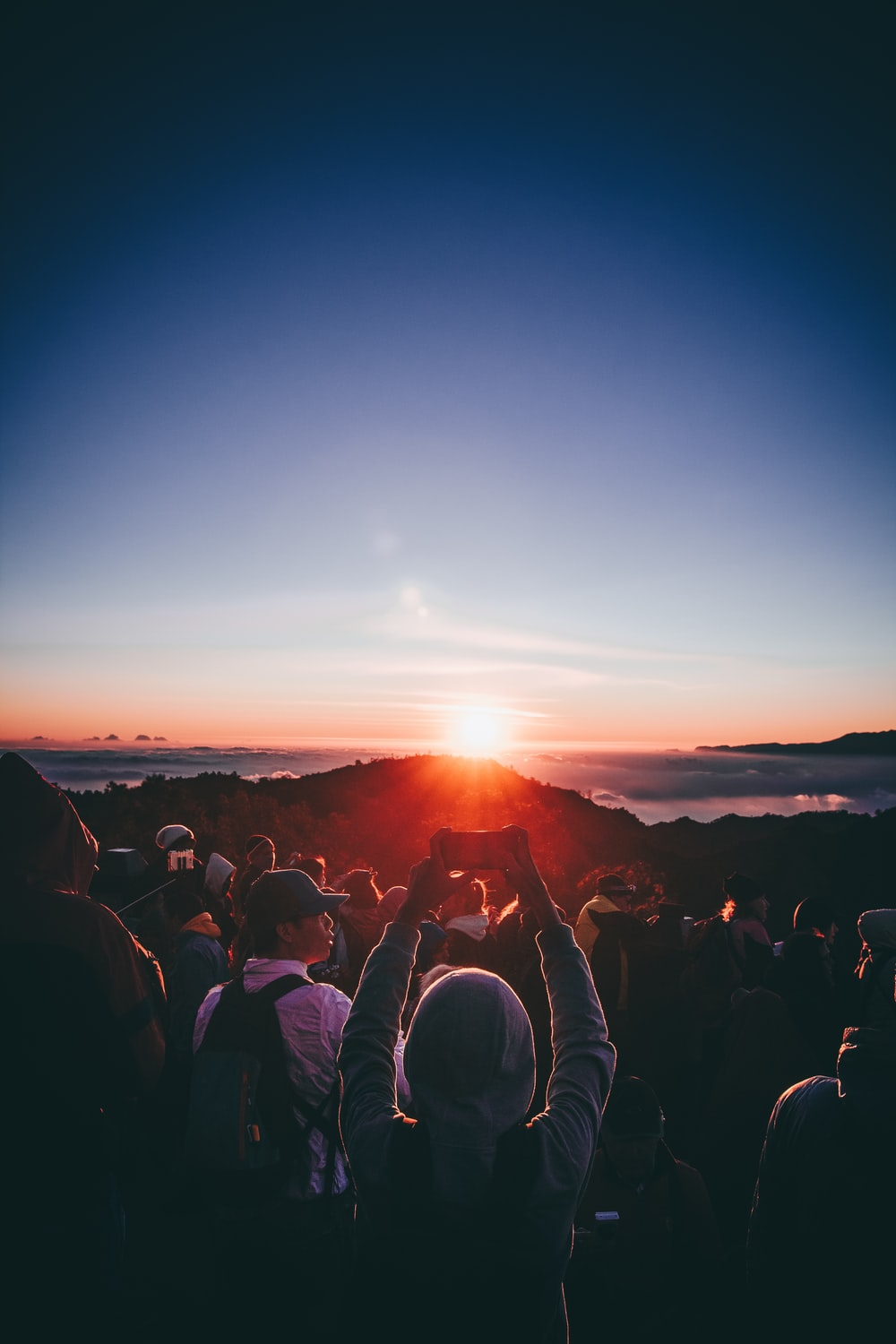 people standing on near mountains during golden hour