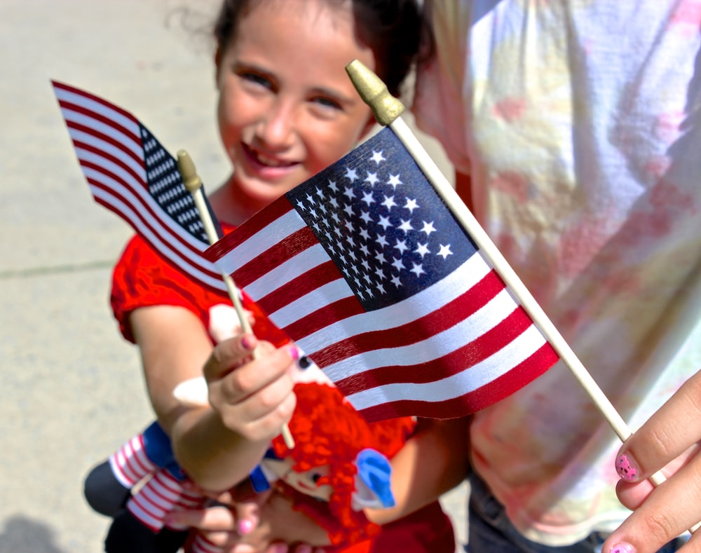 child holding flag of America