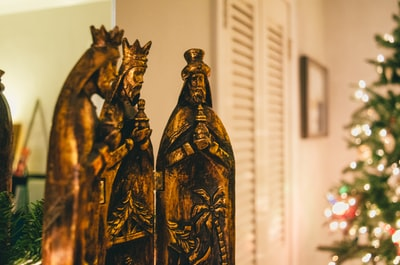 selective focus photography of religious figurines wise men zoom background