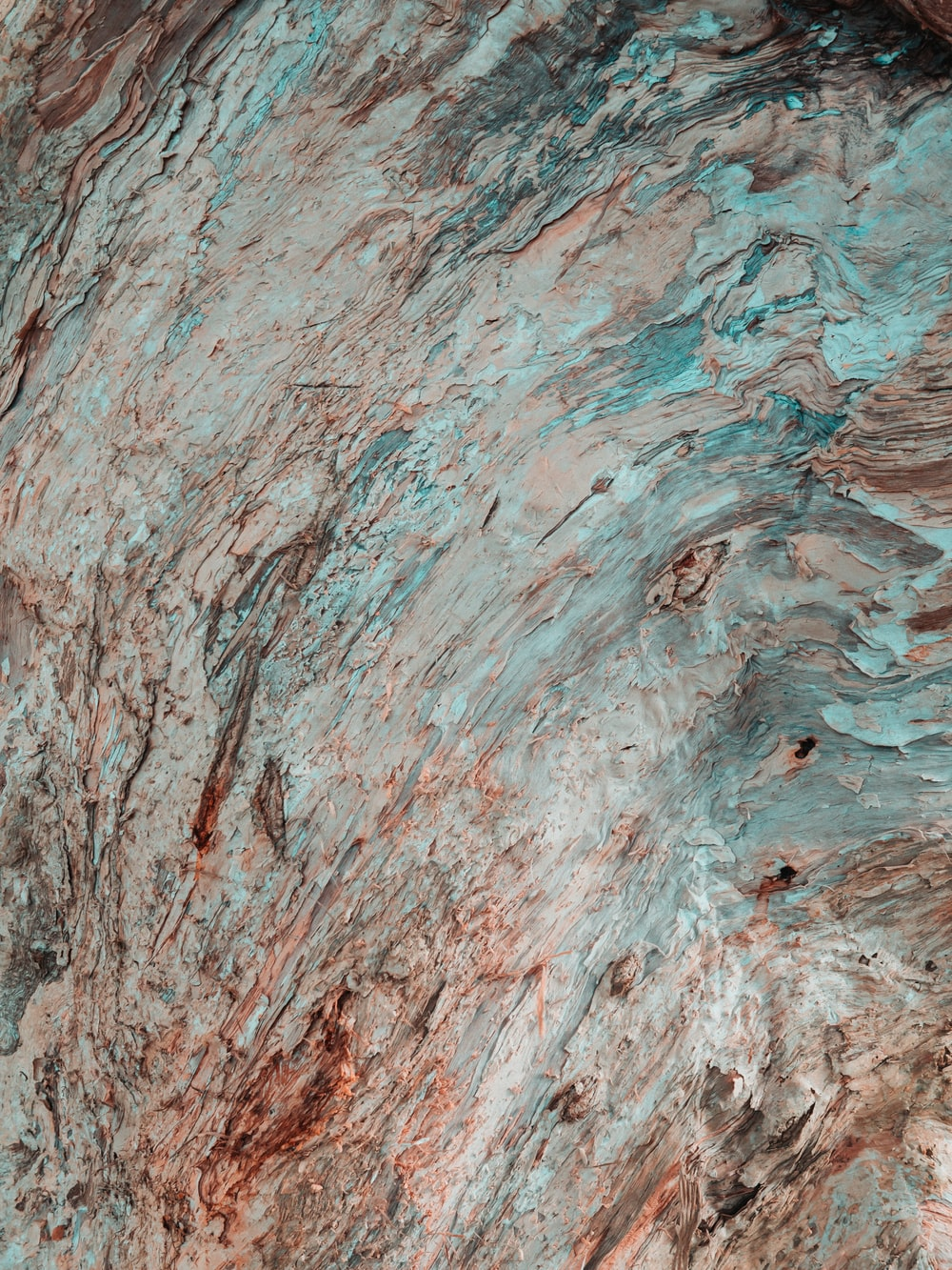 red and blue rock in closeup photo