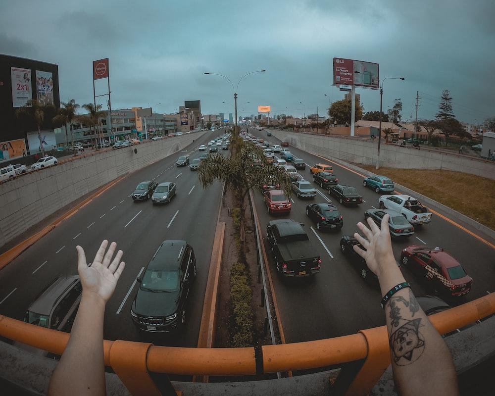 vehicles on road passing bridge