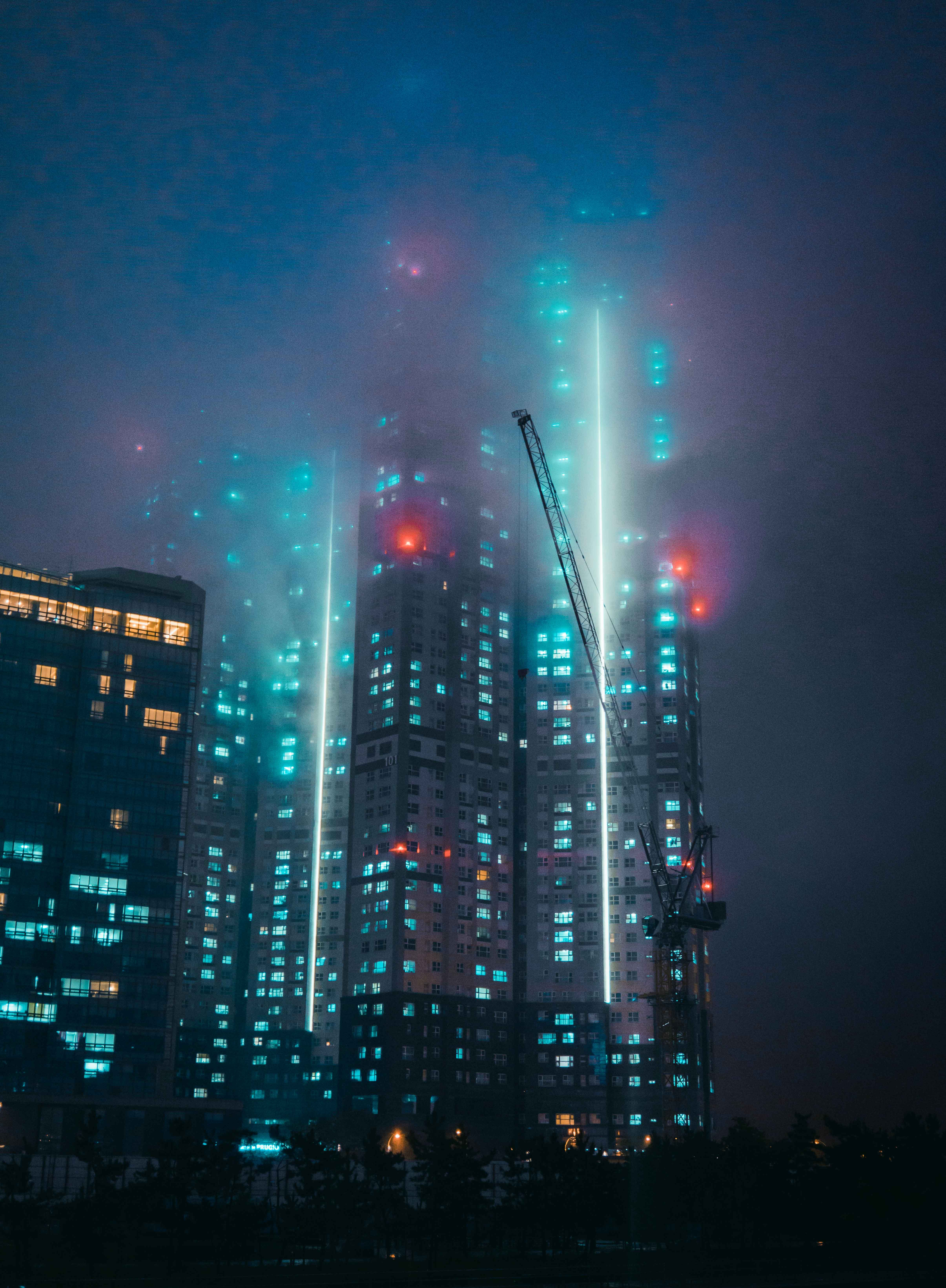 high rise buildings with lights illustration