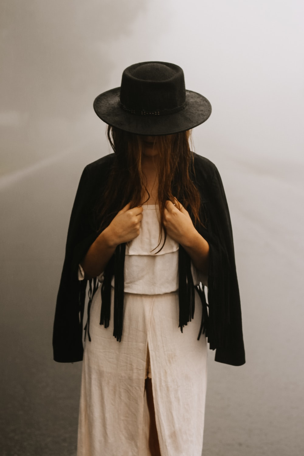 woman wearing brown dress and black hat