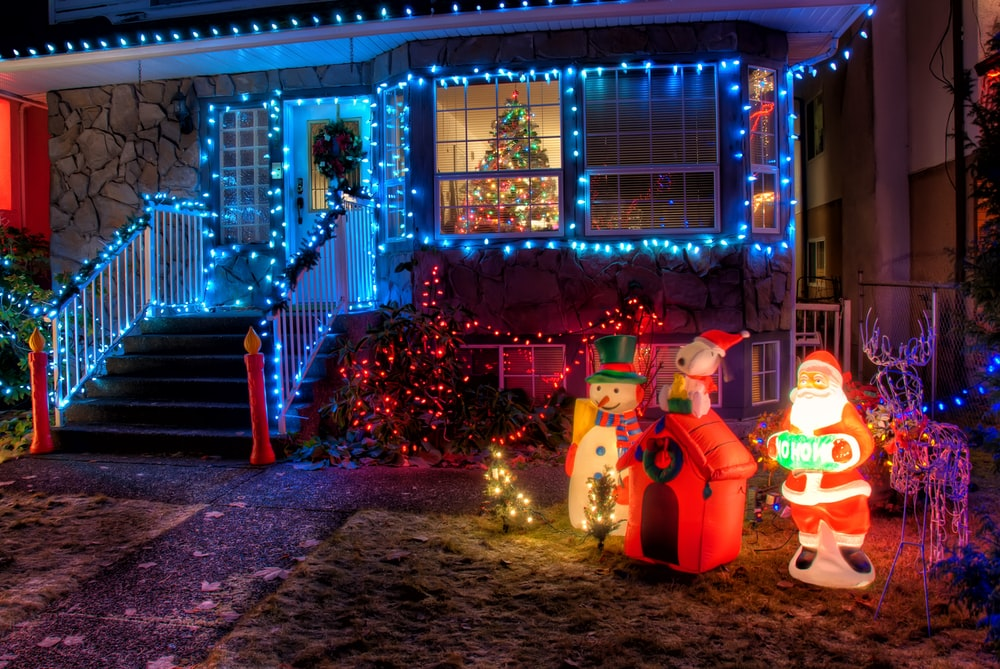 snowman and santa claus near house decor