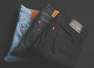 three assorted-color denim bottoms