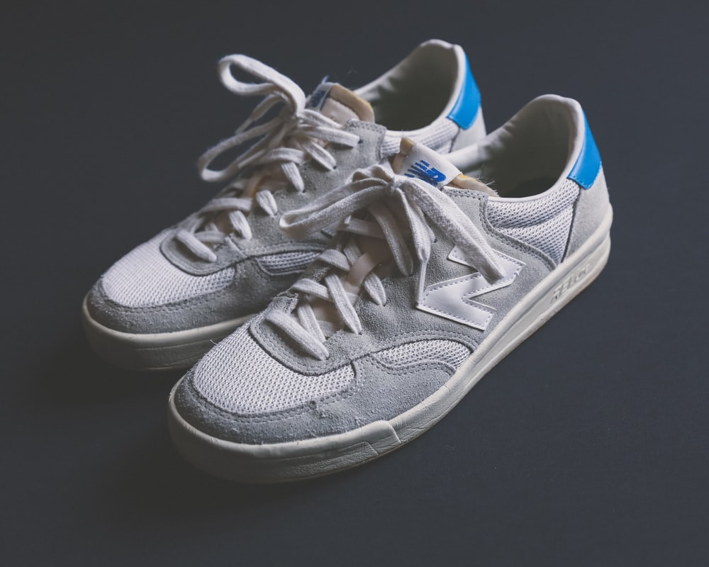 pair of white New Balance shoes