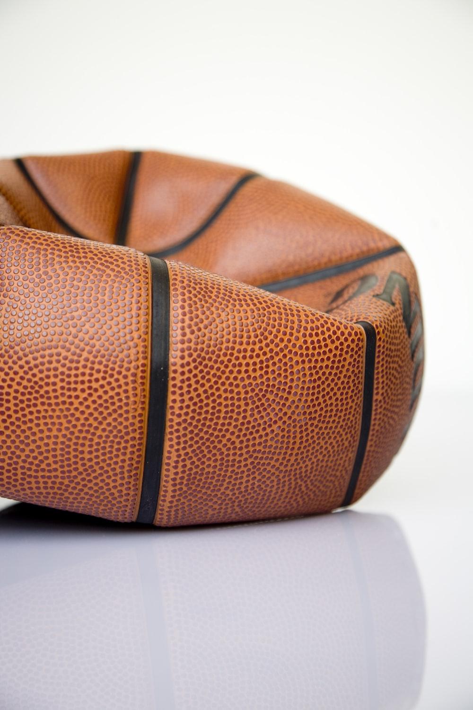 brown basketball ball on white surface