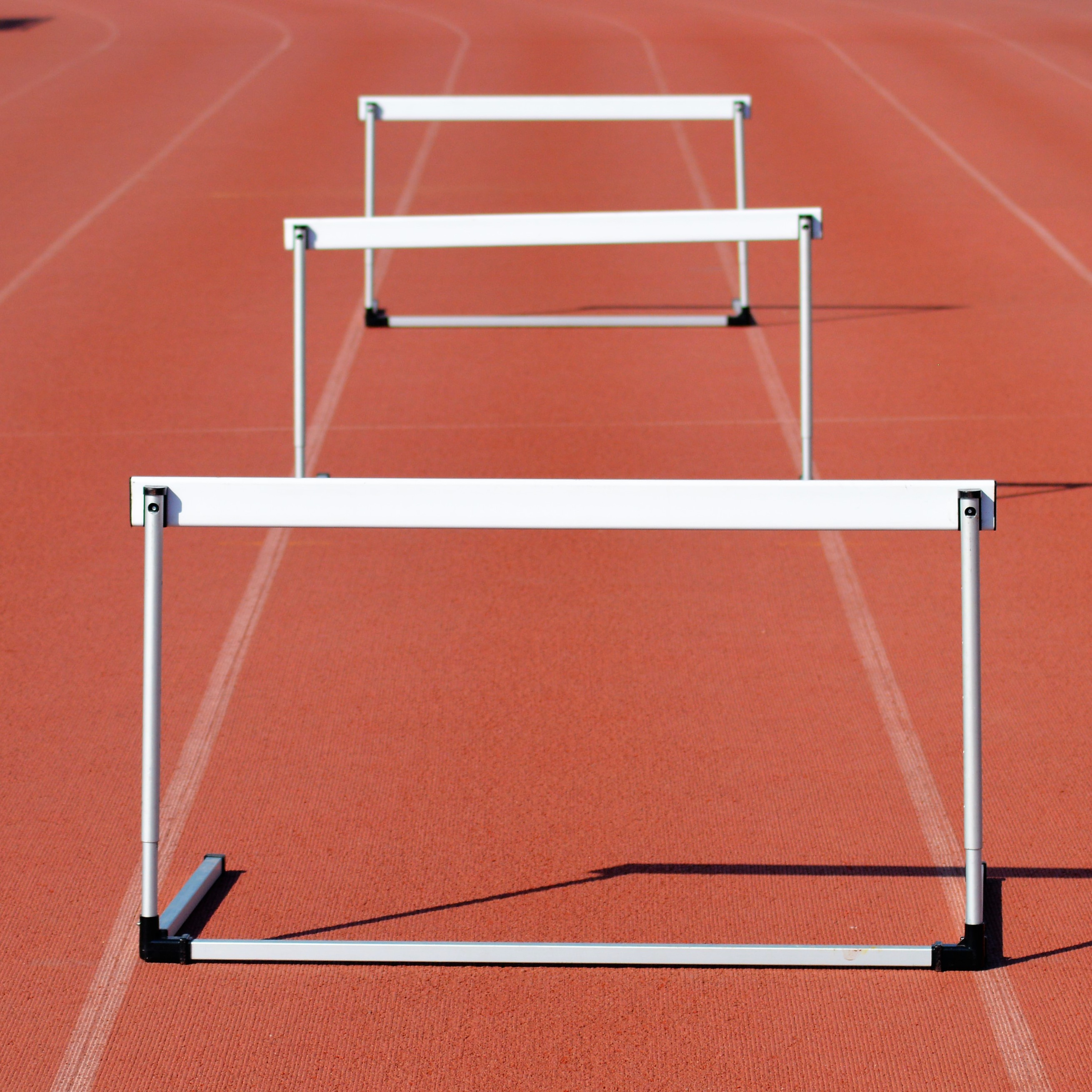 white track field with white ramsp