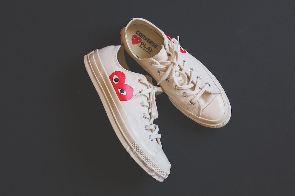 pair of women's white sneakers