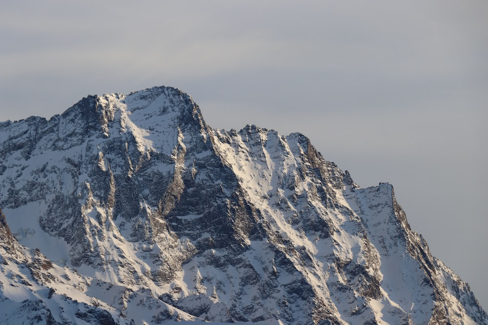 white and grey glacier mountain at daytime