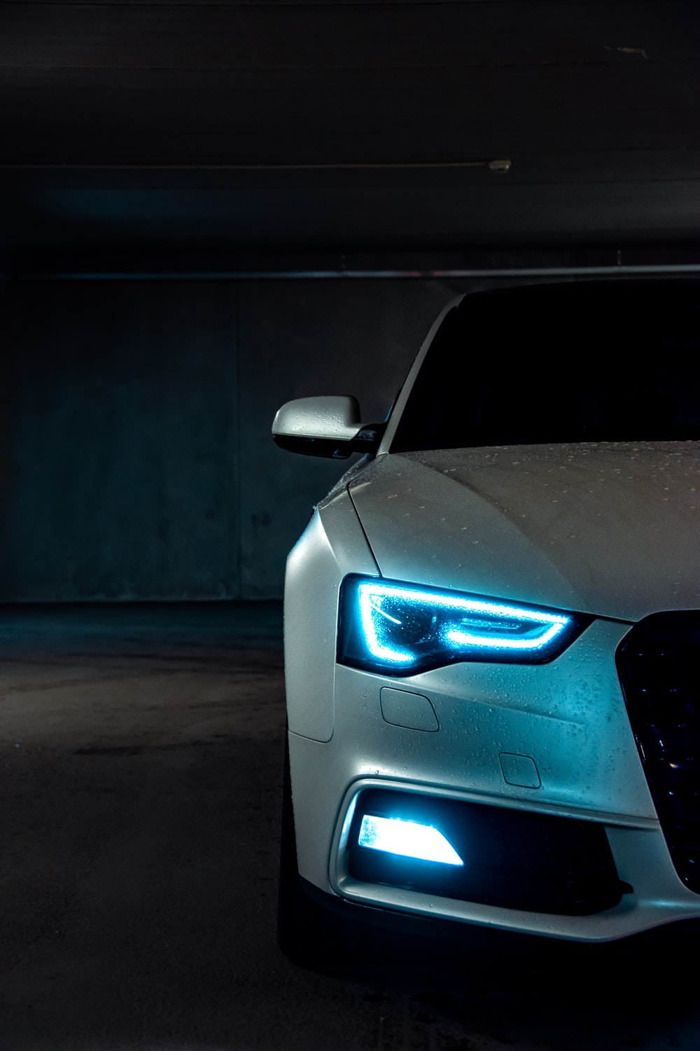 white vehicle with blue neon headlight bulb