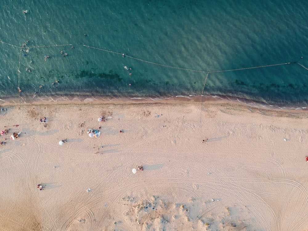 aerial photography of sand and sea