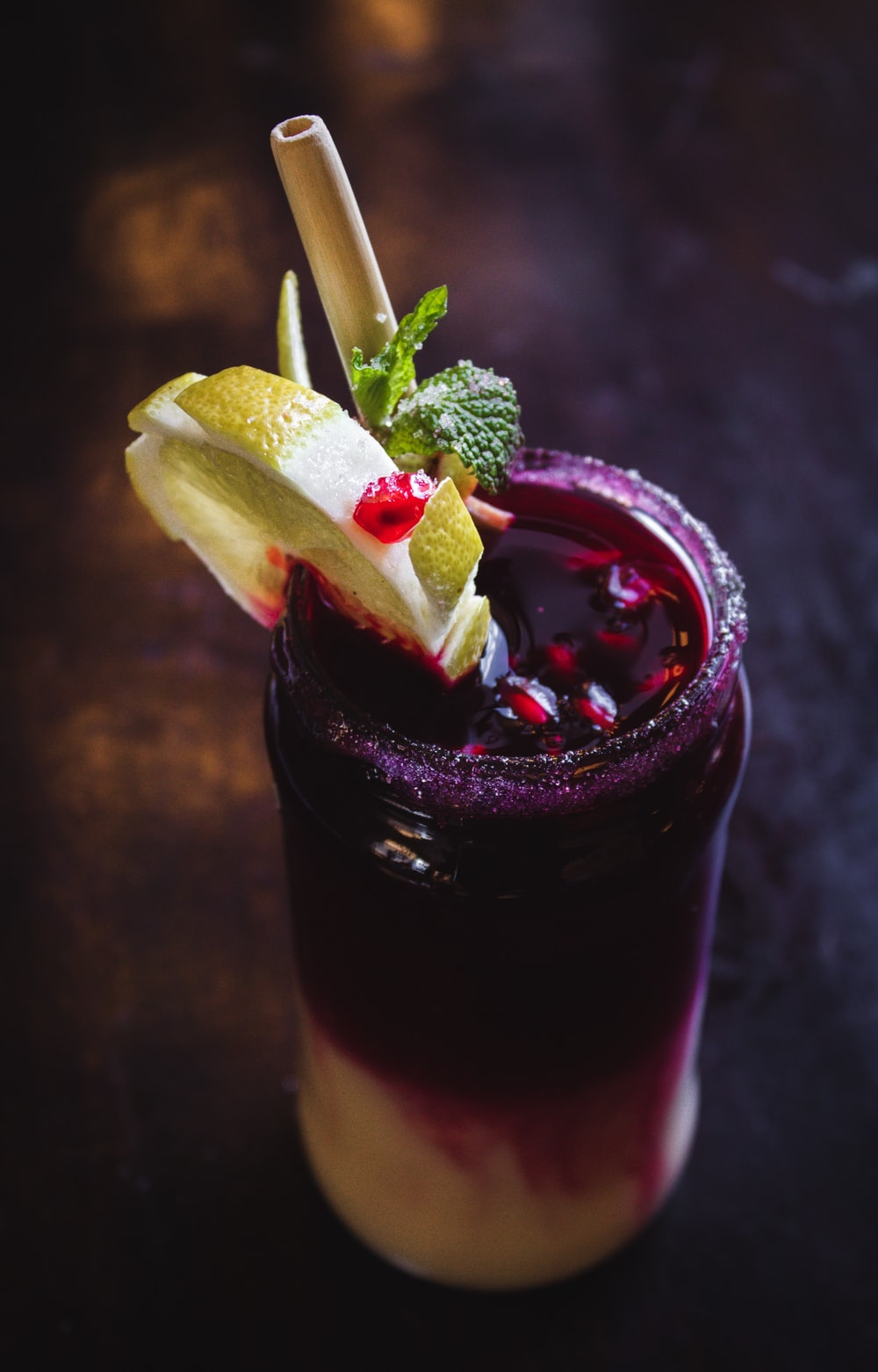 purple drink with straw and lemon slice