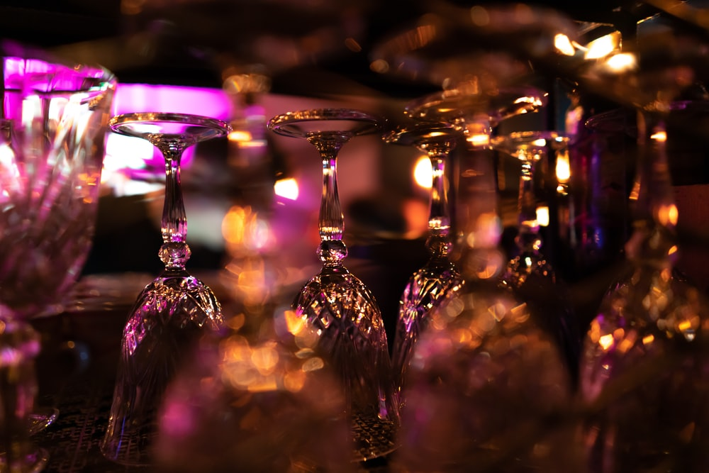 selective focus photography of clear glass stem glasses