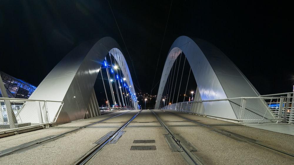 lighted concrete bridge during nighttime